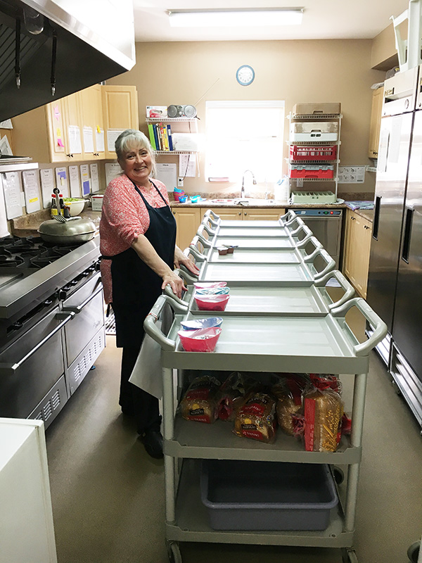 west ridge early education centre cafeteria employee preparing food for students